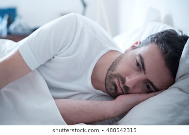 depressed-man-lying-his-bed-260nw-488542315